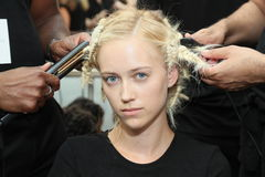 A model getting ready backstage before the Carmen Marc Valvo Spring/Summer 2017 Fashion Show Stock Photos