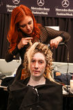 A model getting ready backstage at the FTL Moda fashion show during MBFW Fall 2015 Stock Photos