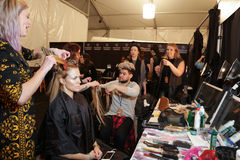 A model getting ready backstage at the FTL Moda fashion show during MBFW Fall 2015 Royalty Free Stock Images