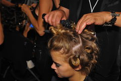 A model getting ready backstage at the Indah fashion show during MBFW Swim 2015 Stock Photos