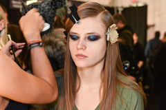 A model getting ready backstage at the Monique Lhuillier fashion show during MBFW Fall 2015 Stock Images