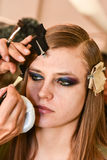 A model getting ready backstage at the Monique Lhuillier fashion show during MBFW Fall 2015 Royalty Free Stock Images