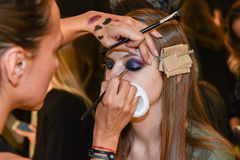 A model getting ready backstage at the Monique Lhuillier fashion show during MBFW Fall 2015 Stock Photography