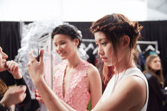 A model getting ready backstage at the New York Life fashion show during MBFW Fall 2015 Stock Photos