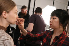 A model getting ready backstage at the Sally LaPointe Fashion show during MBFW Fall 2015 Royalty Free Stock Photos