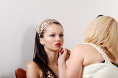 Model getting red lipstick applied Stock Images
