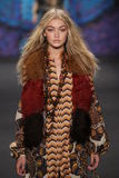 Model Gigi Hadid walks the runway at the Anna Sui fashion show during MBFW Fall 2015 royalty free stock image