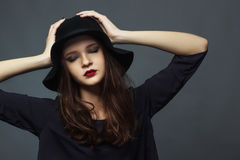 Model girl in felt hat Royalty Free Stock Photography