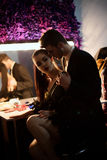 Model girl and her boyfriend at make up room after show she took part in Stock Photography