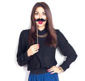 Model girl holding funny mustache on stick Royalty Free Stock Photo