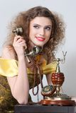Model girl talking by vintage phone Royalty Free Stock Images