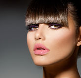 Model Girl With Trendy Fringe. Fringe. Fashion Model Girl With Trendy Hairstyle and Makeup Stock Images