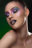 Model girl with vivid make up on dark green background Royalty Free Stock Images