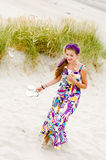 Model girl walking in sand dunes beach stock images