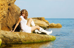 Model girl in white dress and boots stock photos