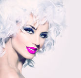 Model girl with white feathers hairstyle Royalty Free Stock Photo