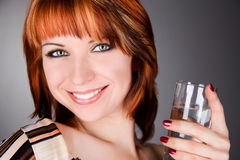 Model with glass of water Stock Images