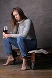Model with glass of wine looking down. Gray background Stock Photo