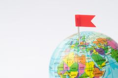 Model Globe With Red Flag Pin In Europe Stock Photos