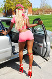 Model going to car. A young model after the outside photo shoot in hot pants with long blond hair Royalty Free Stock Image