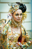Model in gold walks the runway during Stock Photography