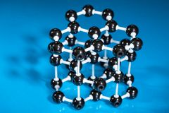 Model of graphite molecular structure. On green reflective background Stock Image