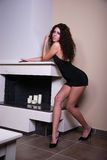 Model from Greece near the fireplace Stock Photography