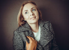 Model in grey coat and yelloy leather gloves Stock Images