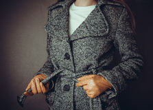 Model in grey coat and yelloy leather gloves Royalty Free Stock Photography
