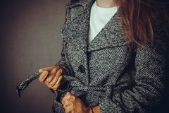 Model in grey coat and yelloy leather gloves Stock Photos