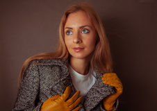 Model in grey coat and yelloy leather gloves Royalty Free Stock Images