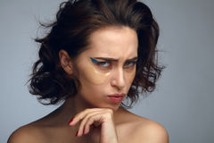 Model grimacing with eyepads on face Royalty Free Stock Photos