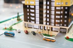 Model of the Grodsky quarter, high-rise building with a lot of apartments parking, road, cars and buses. Macro shooting.  Stock Image