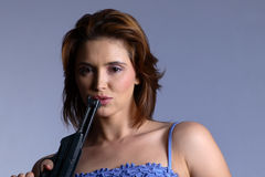 Model with gun Royalty Free Stock Photography