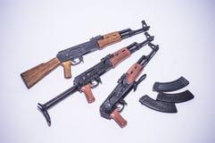 Toy weapons Miniature ak guns figure white background Stock Photo