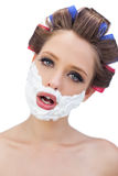 Model in hair curlers with shaving foam in close up Royalty Free Stock Photography