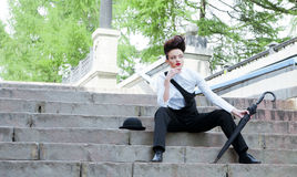 Model with a hairdress in an elegant suit Stock Images