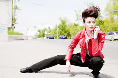 Model with a hairdress in an elegant suit Royalty Free Stock Image