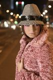 Model in hat. Model in a black and white hat and pink fur Stock Photography