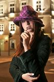 Model in hat. Model in a black and white hat and pink fur Royalty Free Stock Photo