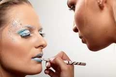 Model having makeup applied Stock Photography