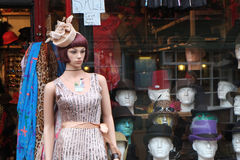 Model and heads in shop. Royalty Free Stock Photography