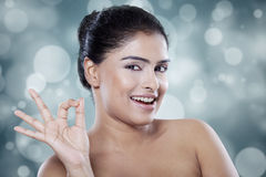 Model with healthy skin on bokeh background Stock Photo