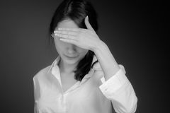 Model hiding face shame Stock Images