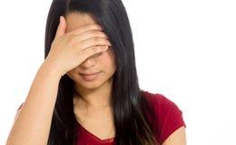 Model hiding face shame Stock Images