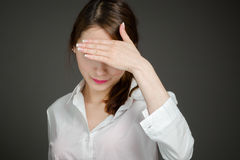 Model hiding face shame Royalty Free Stock Image