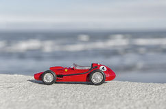 Model of a historical car over the sea Royalty Free Stock Photos