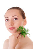 Model holding a batch of dill in her hand Stock Photo