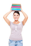 Model holding books on her head Royalty Free Stock Photos