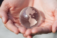 Model holding crystal glass globe in hands with care Royalty Free Stock Photo